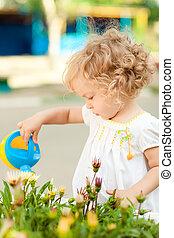 Child in summer garden - Smiling child in summer garden