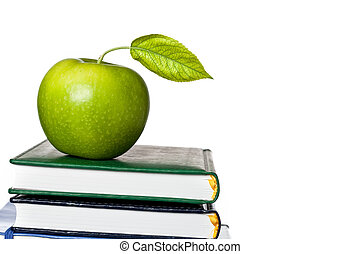 Green apple on textbook isolated - Green apple with fresh...