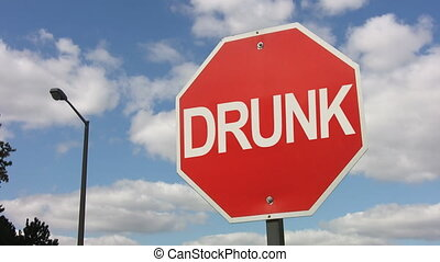Stop drunk driving. Timelapse. - Stop sign with the word...