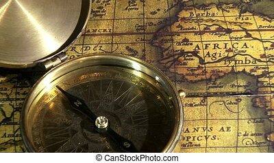 Golden compass and old maps, zoom