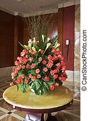 Elegant vase with flowers in a lobby of dear hotel
