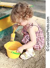 Child in sandbox