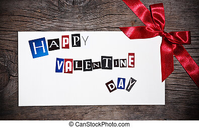 Happy Valentine`s day - Valentine`s card with bow on old...