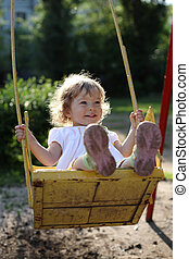 Playing on the swings after summer rain - shallow depth of...