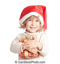 Happy child with Christmas gift isolated on white background