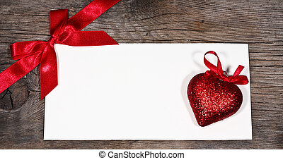 Valentine`s card blank and heart on old wood