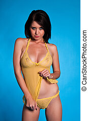 Yellow lingerie - Beautiful young brunette dressed in yellow...