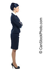 Full length, side view of a confident young business woman...