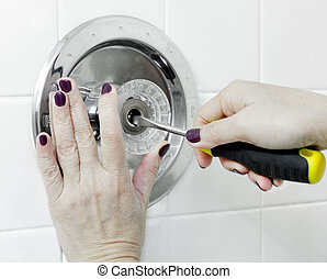 Repair Faucet - Woman's hands with purple shellac manicured...