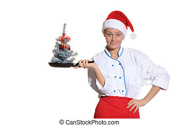 woman-cook with frying pan and Christmas tree - happy...
