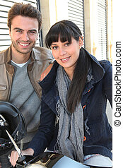 Young couple smiling in the street