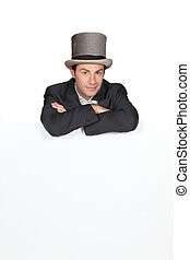 Man in a top hat with a blank board