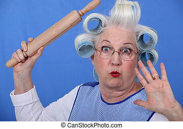 Scared old lady with hair rollers