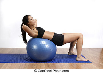 Asian woman in gym - Young Asian woman with Pilates ball
