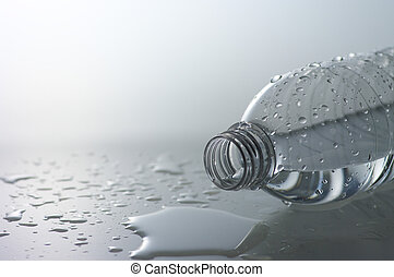 Spill a bottle - Spilled water and plastic bottle.