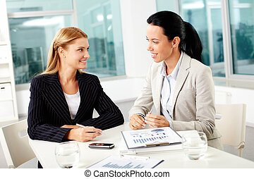 Females working - Portrait of two young businesswomen...