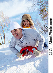Happy activity - Portrait of happy mature couple riding on...