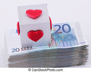 20 Euro bills - A cube of red hearts on a wad of 20 Euro...