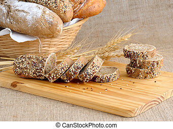 Diverse bread with slices of bread with grains