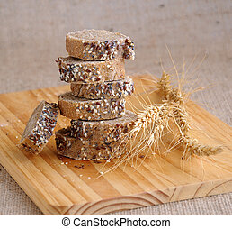 A stack of slices of bread with grains