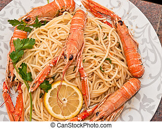 shrimps cooked   with  italian pasta with lemon and parsley