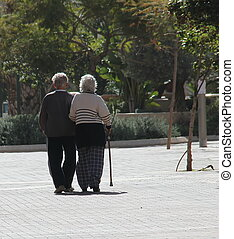 Couple of seniors walking in a big - Couple of seniors...
