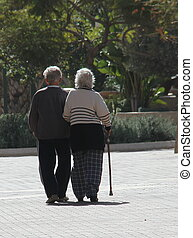 Couple of seniors walking in a big city