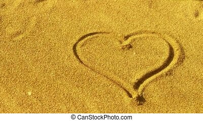 heart on golden sandy beach,wind blow sand