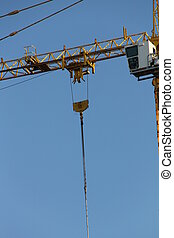 Construction cran - Detail of construction crane on blue sky...