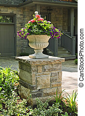 Stone planter in front of house - Stone planter with flowers...