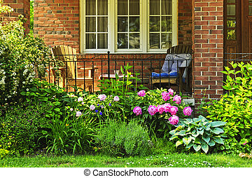 Garden in front of house - Front of home with chairs and...