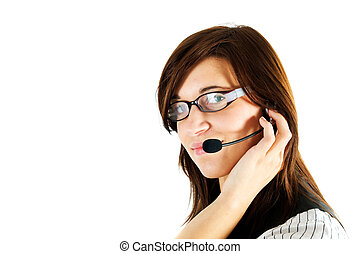 Friendly customer service agent smiling during telephone...
