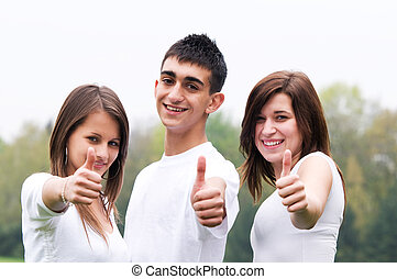 Happy friends giving okay sign - Three young happy friends...