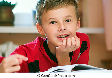 Boy reading book portrait - Portrait of young boy reading...