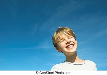 Happy boy on sky background