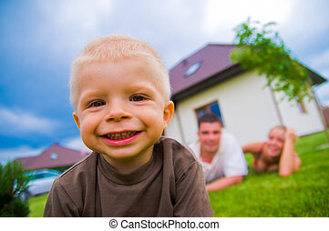 Happy child, happy life - Happy child in front of the house...