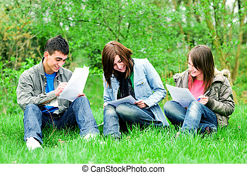 Young students learning outdoor - High school students...
