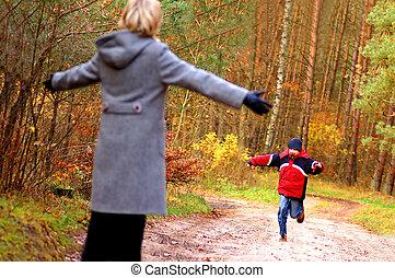 Family love - Family having fun outdoor in autumn scenery