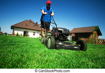 Mowing the lawn - Man mowing the lawn Gardening