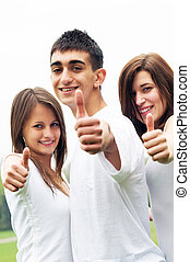 Happy friends giving okey sign - Three young happy friends...