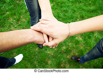 Friends united - Group of friends joining hands. Unity,...