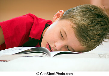 Fell asleep after studying... - Young boy fell asleep after...