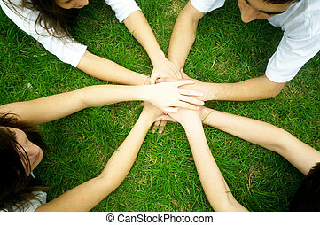 Friends united - Group of friends joining hands Unity,...