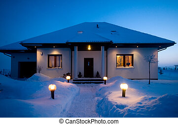 House in winter. Lots of snow, evening mood
