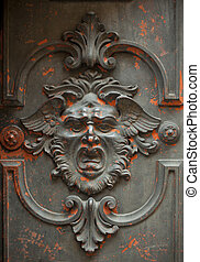 Monstrous face carved in a door - Monstrous face carved into...