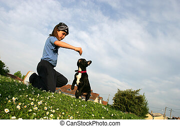 Little girl in a park with her dog