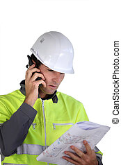 Worker with a two-way radio
