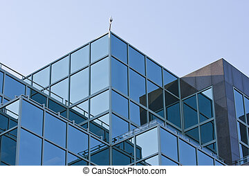 Reflecting Geometry - Reflections in the windows of a modern...