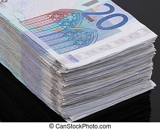 20 Euro bills - A wad of 20 Euro bills on black background