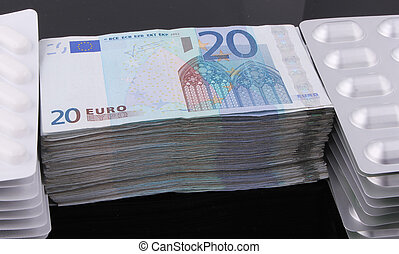 20 Euro bills - A wad of 20 Euro bills with tablet packaging